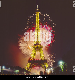 The Eiffel Tower illuminated at night with big colourful exploding firework display Paris France - Stock Photo