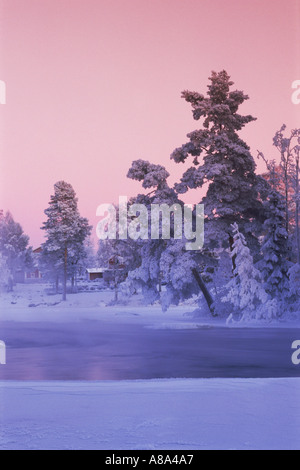 Frosty day along Dal River in Dalarna Province of Swedish in low winter light - Stock Photo