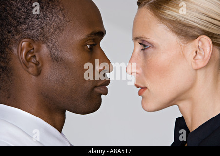 Man and woman face to face - Stock Photo