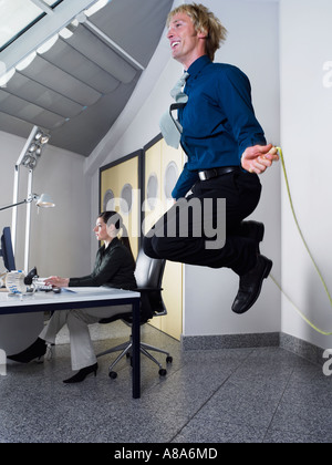 Man skipping in office - Stock Photo
