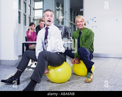 Office workers on hoppers - Stock Photo