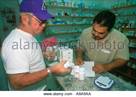 Senior Citizens buying Prescription Drugs in Mexico to save money - Stock Photo
