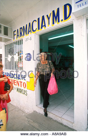 United States Senior Citizens buying Prescription Drugs in Mexico to save money and their lives - Stock Photo