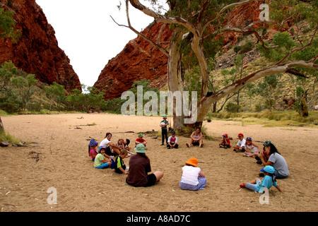 Schoolchildren at Simpson's gap in Central Australia - Stock Photo