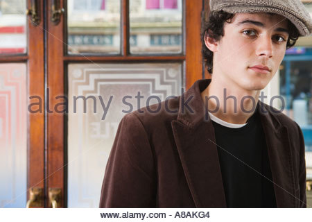 Young man in pub - Stock Photo
