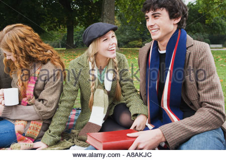 Three friends having picnic - Stock Photo