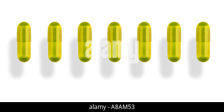 tablets caps in a row Tabletten Kapseln in einer Reihe - Stock Photo