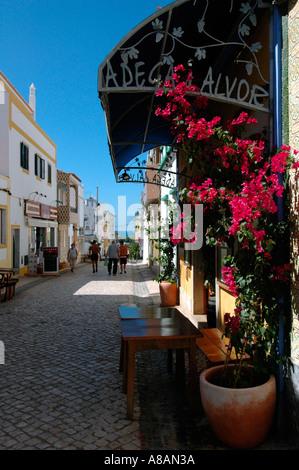 Street scene in Alvor a seaside resort and fishing village in Algarve the southernmost region of Portugal - Stock Photo