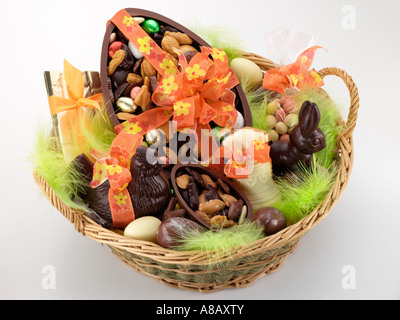 Wicker basket full of French chocolate eggs and animals editorial food - Stock Photo