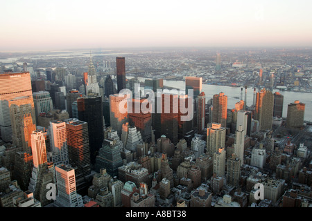 view from the empire state building over the east side and east river over to brooklyn at sunset - Stock Photo