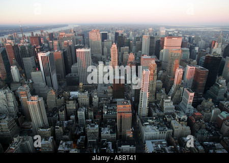 view from the empire state building over the hudson river over to new jersey at sunset - Stock Photo