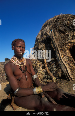 Karo woman with traditional lip plug and scarification , Kolcho , South Omo valley , Ethiopia - Stock Photo
