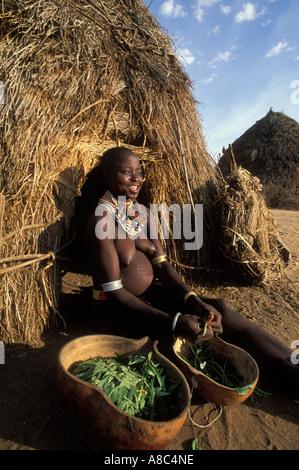 Karo woman preparing food , Kolcho , South Omo valley , Ethiopia - Stock Photo