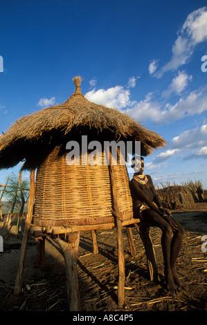 Karo girl at a granary , Kolcho , South Omo valley , Ethiopia - Stock Photo