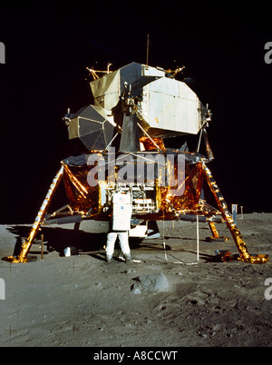 Apollo 11 Lunar Module on the Moon An  Astronaut is Shown Working at the Modularized Equipment Stowage Assembly - Stock Photo