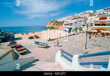 Boats lying at the beach of Carvoeiro Algarve Portugal Europe - Stock Photo