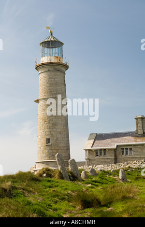 UK Lundy Island ancient Christian headstones in old cemetery by old lighthouse - Stock Photo