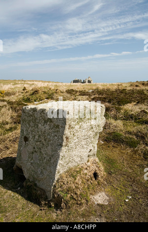 UK Lundy Island granite block marking edge of central road and remains of old quarry hospital - Stock Photo