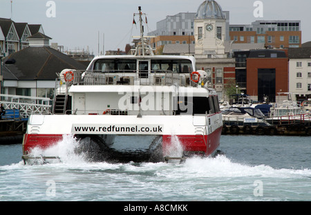 Red Jet 4 a passenger catamaran of Red Funnel arriving at Town Quay Southampton on the service from Cowes Isle of - Stock Photo