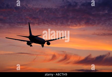 Plane Landing at London Heathrow Middlesex England UK - Stock Photo
