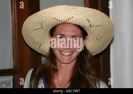 Young lady girl big nice smile looking at camera with straw hat. - Stock Photo