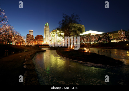 Evening skyline of Omaha Nebraska from the Gene Leahy mall - Stock Photo