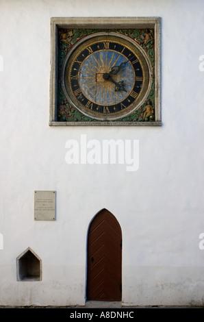 Decorative clock and entrance Church of the Holy Spirit Old Town Tallinn Estonia - Stock Photo