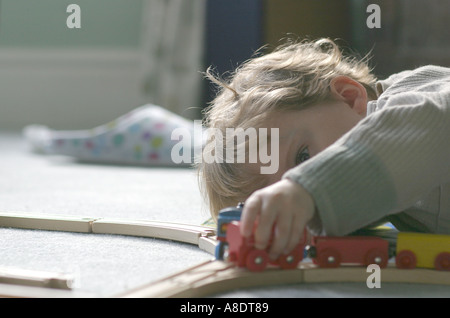 Little Kid Playing With Trainset