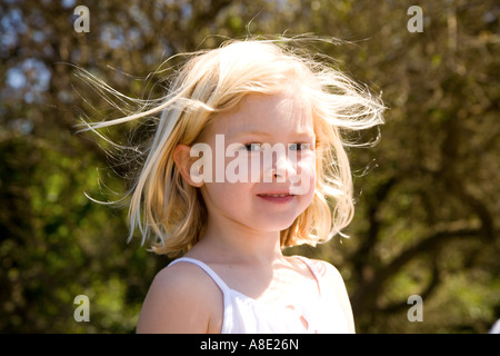 Portrait of young girl on beach - Stock Photo