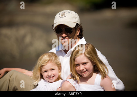 Father with daughters on beach - Stock Photo
