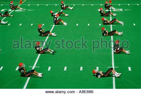 High school football practice Seatlle Washington on Astro Turf - Stock Photo