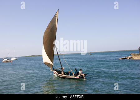 Arab dhow sailing off coast of Lamu Island Kenya - Stock Photo