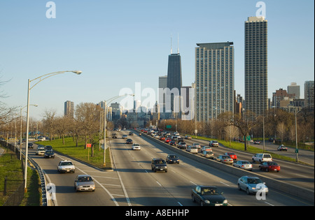 CHICAGO Illinois Traffic on entrance ramp merge onto Lake Shore Drive downtown highrises multilane highway - Stock Photo