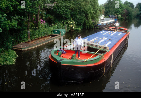 The restored 1935 Wey Barge Perseverance navigates the Wey Navigation at Byfleet Surrey England UK - Stock Photo