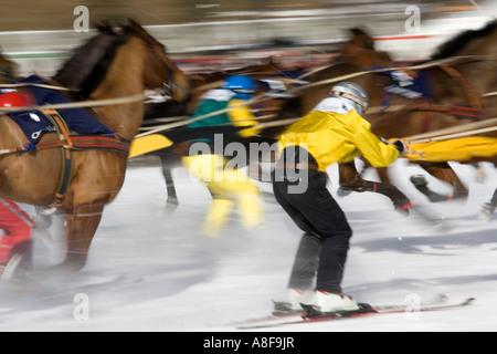 Ski Jouring behind horses on the frozen lake at St Moritz, Switzerland. - Stock Photo