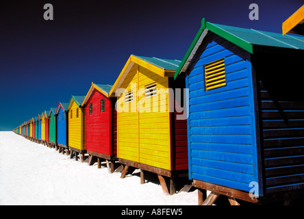 brightly-coloured beach huts on beach, Muizenberg, Cape Town, South Africa - Stock Photo