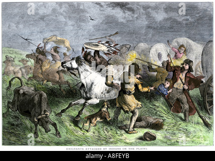 Native American war party attacking a wagon train of settlers on the Great Plains 1800s. Hand-colored woodcut - Stock Photo