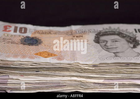 Pile of ten pound notes sterling - Stock Photo