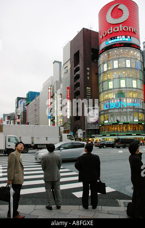 Businessmen on Ginza Street Tokyo Japan - Stock Photo