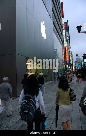 Shopping at Apple Store on Ginza Shopping District in Tokyo Japan - Stock Photo