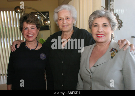 Key Biscayne Florida Hispanic Cuban relatives plan family reunion meeting senior female younger relatives - Stock Photo