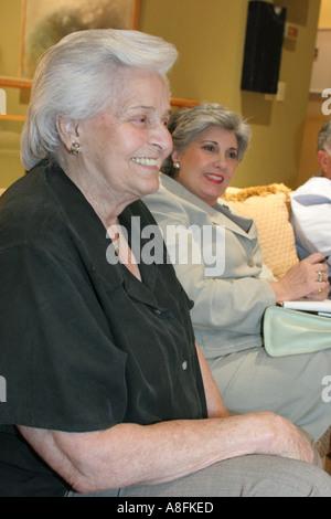 Key Biscayne Florida Hispanic Cuban relatives plan family reunion meeting talking listening senior female - Stock Photo