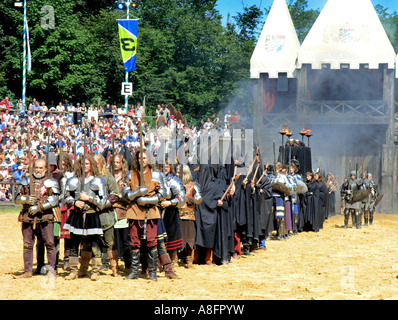 Knights on horse holding lance flag in tournament Medieval festival in Kaltenberg Bavaria Germany - Stock Photo