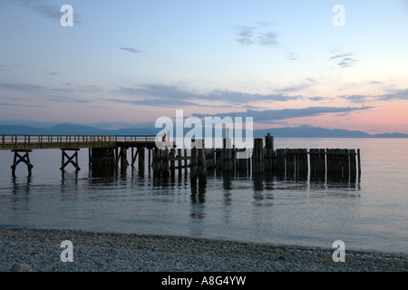 Sunset over the pier at Davis Bay, British Columbia on the Strait of Georgia - Stock Photo