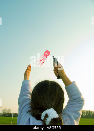 child flying a kite - Stock Photo