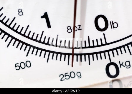 Close up of the dial on kitchen weighing scales at eight ounces - Stock Photo