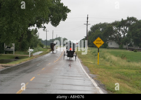 Amish Carriages on Rain Slicked Road Yoder Kansas
