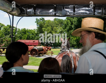 Bearded Amish Buggy Driver and Young Passengers Amish Farm and House Lancaster Pennsylvania - Stock Photo