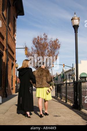 Well Dressed Caucasian Teen Girls 13 to 15 Years Walk on City Sidewalk USA - Stock Photo