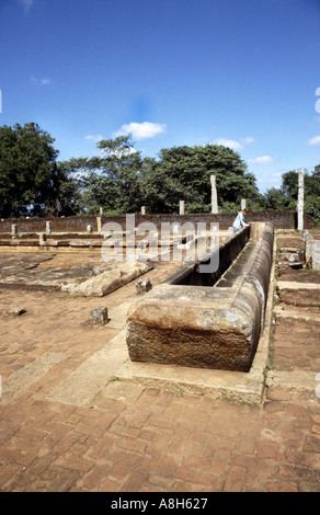 A stone trough believed to have once held rice for monks at Mihintale in northern Sri Lanka - Stock Photo